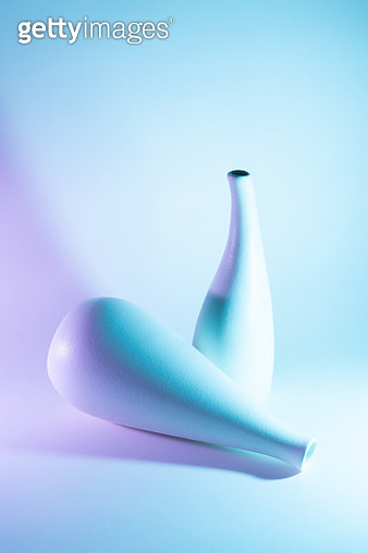 Two Vases with Purple and Blue Gradient Colored Light Effect. - gettyimageskorea