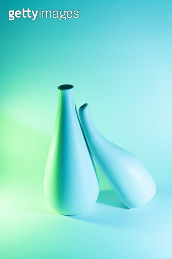 Two Vases with Blue and Green Gradient Colored Light Effect.Romance Concept. - gettyimageskorea