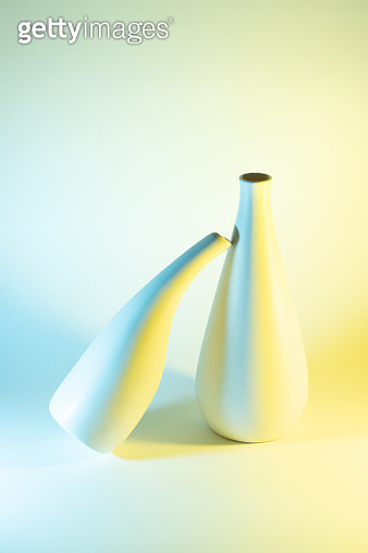 Two Vases with Blue and Yellow Gradient Colored Light Effect. - gettyimageskorea