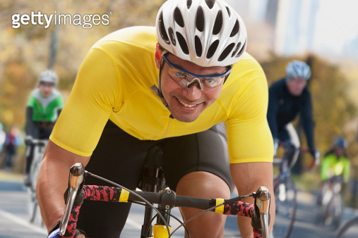 Mixed race man in bicycle race - gettyimageskorea