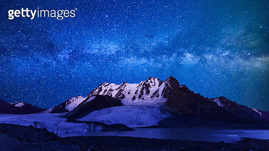 Milky way over mountain in snow, Xinjiang Uygur Autonomous Region, China - gettyimageskorea