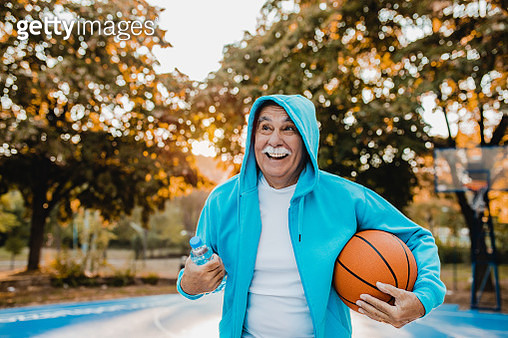 Portrait of active senior man on basketball field - gettyimageskorea