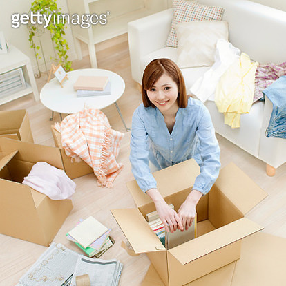 Woman Packing Household Goods - gettyimageskorea