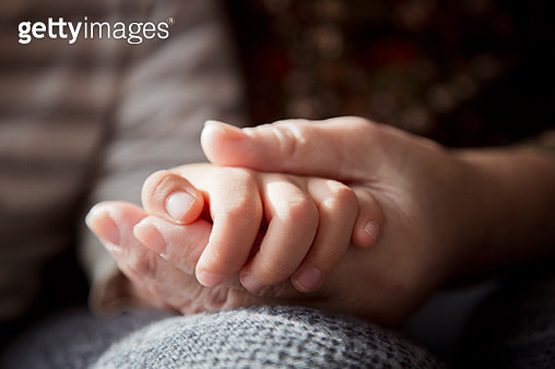 A senior woman's hand holding a boy's hand - gettyimageskorea