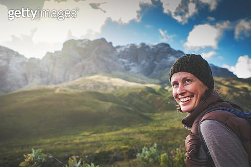 Happy Female Hiker Looking Over her Shoulder - gettyimageskorea