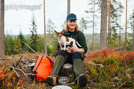 Smiling man with dog - gettyimageskorea