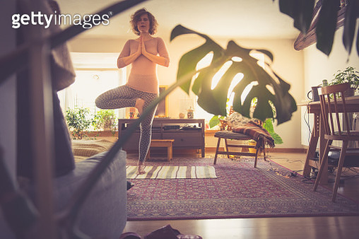 Woman relaxing with yoga at home - gettyimageskorea