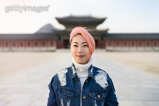 Portrait of young woman with pink colored hair - gettyimageskorea