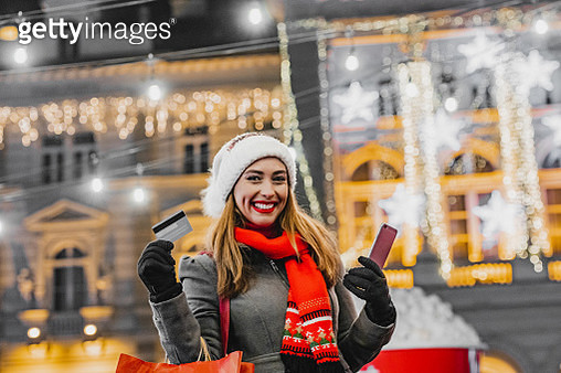 Young woman in a Christmas shopping - gettyimageskorea