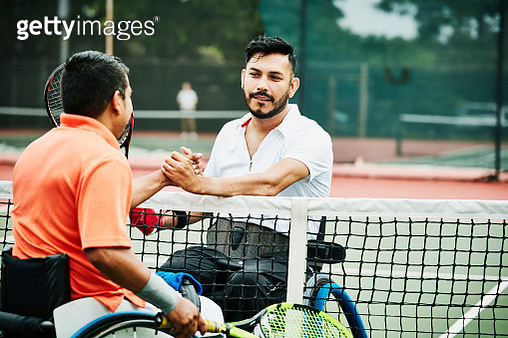 Adaptive athletes shaking hands and congratulating each other after wheelchair tennis match - gettyimageskorea