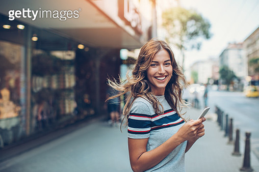 Beautiful city girl with smart phone - gettyimageskorea