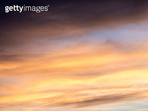 Full frame of the low angle view of  sky and clouds of golden and orange color and the shining sun. Valencian Community, Spain - gettyimageskorea