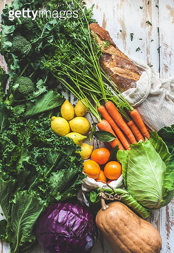 Fresh ingredients from the Sabaris Farmer's market, in Spain in early Winter. Butternut, red cabbage, kale, sprouted broccoli, carrots, mandarins, lemons and fresh bread all made their way home from the chily outdoor market. - gettyimageskorea