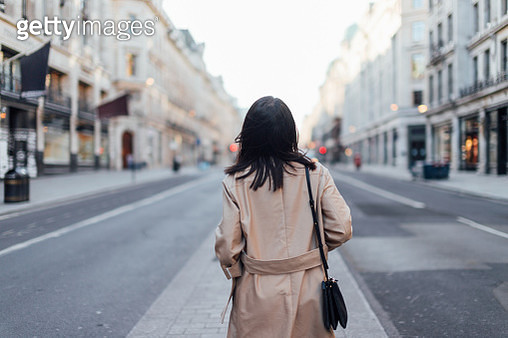 Rear View Of A Young Woman Exploring And Discovering Regent Street, London - gettyimageskorea