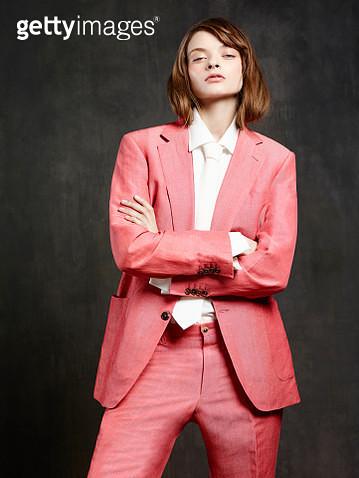 Portrait of woman wearing pink suit - gettyimageskorea