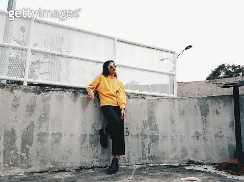 Full Length Of Woman In Yellow Sweater - gettyimageskorea