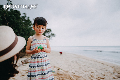 Portrait of adorable mixed race little girl on beach - gettyimageskorea