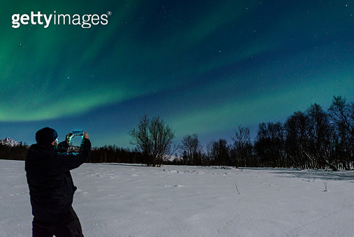 Man taking a picture of the Aurora Northern Polar light - gettyimageskorea