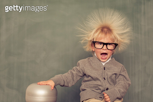 A young, intelligent nerd explores the depths of electricity. - gettyimageskorea