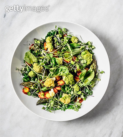 A bowl of fresh salad on white background - gettyimageskorea