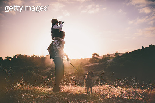 Young father with son and family dog hiking on mountains - gettyimageskorea