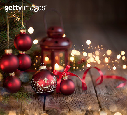Christmas tree with red baubles & nativity Christmas ornaments on an old wood background with defocused lights - gettyimageskorea