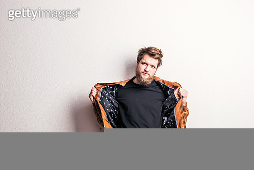 Portrait Of A Young Hipster Man In A Studio. Copy Space. - gettyimageskorea