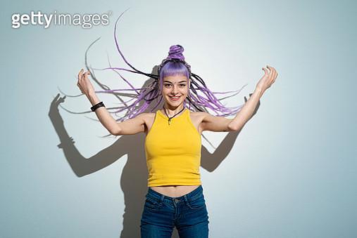 Woman with pink rasta hair - gettyimageskorea