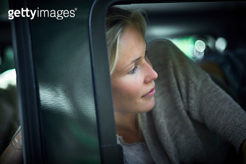 Young woman in an of off-road vehicle - gettyimageskorea