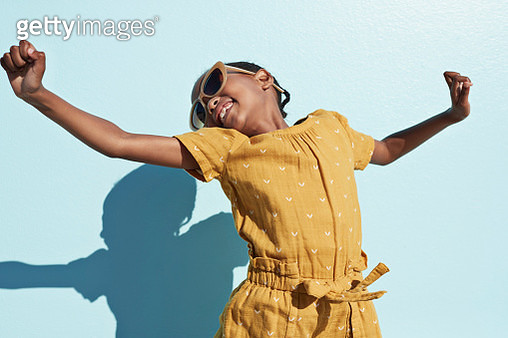 Portraits of joyful kids on blue backdrop, shot outside on a beach in sunlight - gettyimageskorea