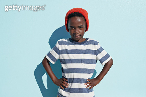 Portrait of cool boy looking in camera, on studio background - gettyimageskorea