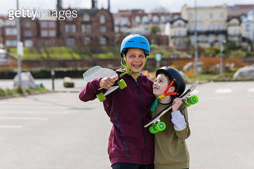 Mother and Son Skateboarders - gettyimageskorea