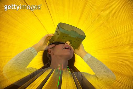 Caucasian woman wearing virtual reality goggles - gettyimageskorea