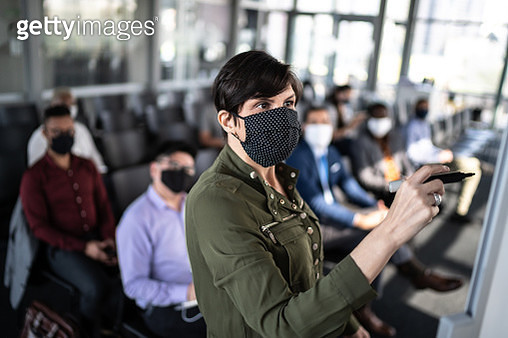 Businesswoman speaking at a business conference - with face mask - gettyimageskorea