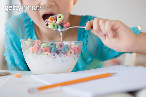 Girl eating bowl of cereal - gettyimageskorea