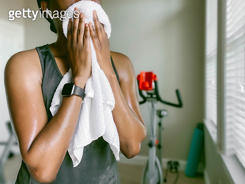 Woman Towels Off After Workout - gettyimageskorea
