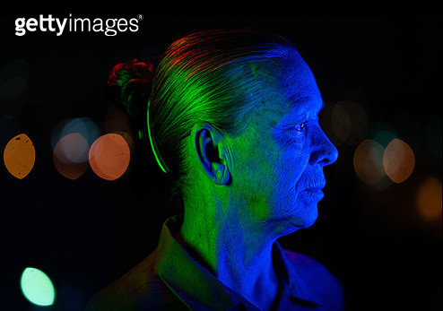 Senior woman with city lights in background - gettyimageskorea