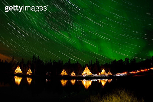 September 7, 2008 - Aurora and Star Trails, Aurora Lake, Yellowknife, Northwest Territories, Canada. - gettyimageskorea