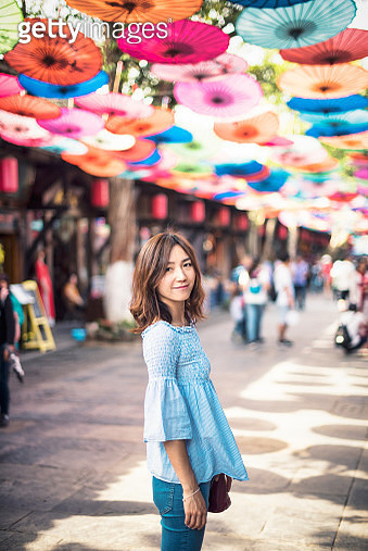 Beautiful Chinese woman standing in an Ancient Chinese town street - gettyimageskorea