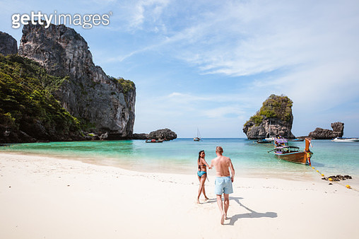 Adult couple relaxing at Ao Nang beach, Ko Phi Phi Don island, Krabi province, Thailand - gettyimageskorea