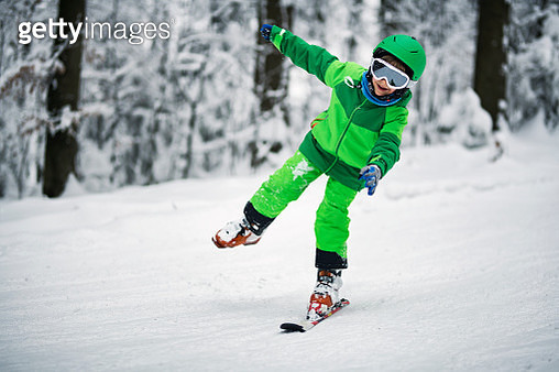 Little boy skiing on one ski - gettyimageskorea