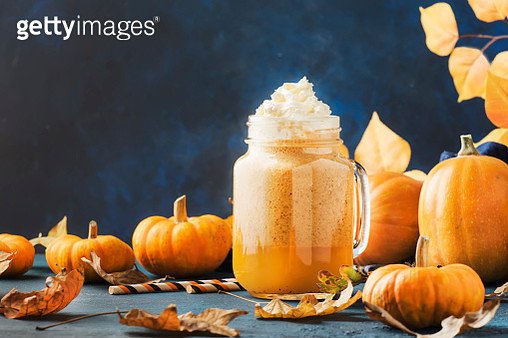 Close-Up Of Pumpkin And Pumpkin On Table - gettyimageskorea