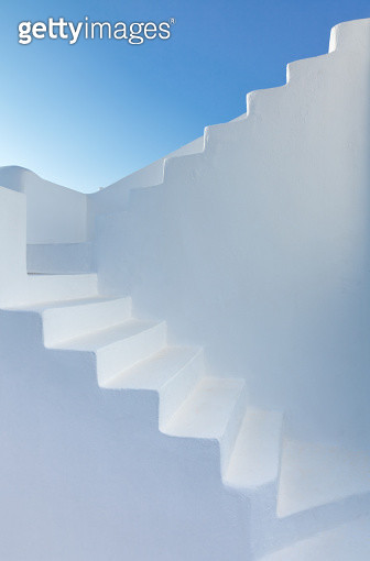 Ethereal staircase against clear blue Mediterranean sky at dawn in Santorini, Greece. - gettyimageskorea