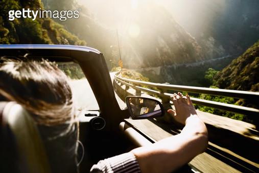 Asian woman in convertible car - gettyimageskorea