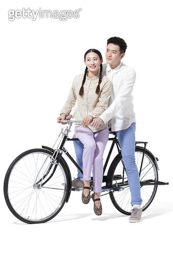 Retro couple riding an old-fashioned bicycle - gettyimageskorea