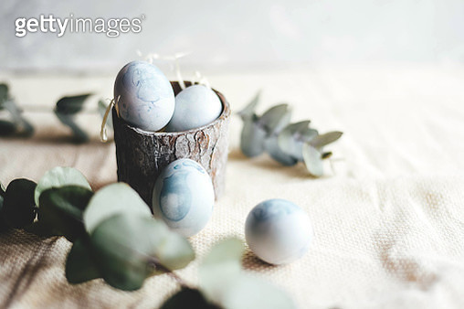 Festive Easter composition with colored eggs in a rustic style. - gettyimageskorea