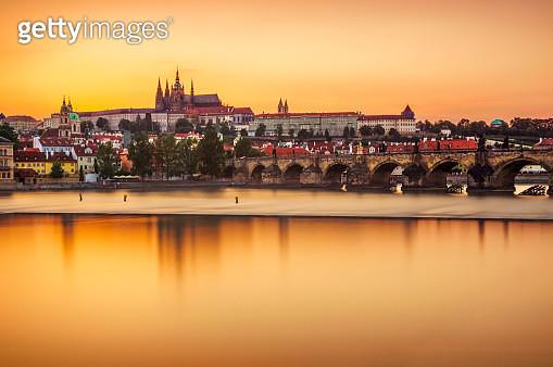 Castle of Prague and Charles bridge reflected on Vltava river at sunset - gettyimageskorea