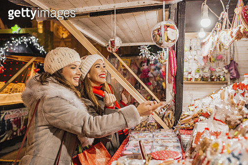 Two female friends on the Christmas market - gettyimageskorea