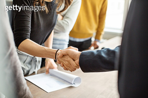 Business people shaking hands in office - gettyimageskorea