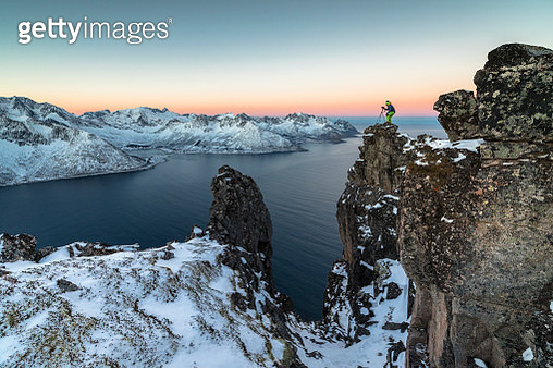Photographer on the rocks, Senja, Norway - gettyimageskorea